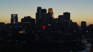 DX0001_002576 - 5.7K stock footage aerial video flyby skyscrapers lit for night in the city skyline at twilight, Downtown Minneapolis, Minnesota