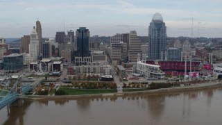 DX0001_002593 - 5.7K stock footage aerial video fly away from city skyline and baseball stadium beside Ohio River, Downtown Cincinnati, Ohio