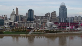 DX0001_002594 - 5.7K stock footage aerial video approach city skyline and baseball stadium from Ohio River, Downtown Cincinnati, Ohio