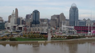 DX0001_002595 - 5.7K stock footage aerial video of flying by city skyline and baseball stadium by Ohio River, Downtown Cincinnati, Ohio