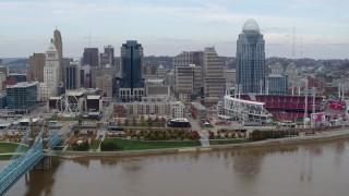 DX0001_002597 - 5.7K stock footage aerial video slowly fly away from city skyline and baseball stadium by Ohio River, Downtown Cincinnati, Ohio