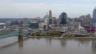 DX0001_002599 - 5.7K stock footage aerial video of a view of the city skyline and bridge by Ohio River during descent, Downtown Cincinnati, Ohio