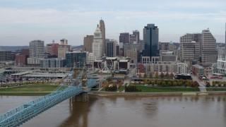DX0001_002601 - 5.7K stock footage aerial video approach city skyline and bridge spanning Ohio River, Downtown Cincinnati, Ohio