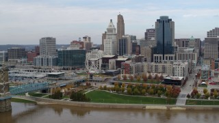 DX0001_002605 - 5.7K stock footage aerial video ascend and approach city skyline from the Ohio River, Downtown Cincinnati, Ohio