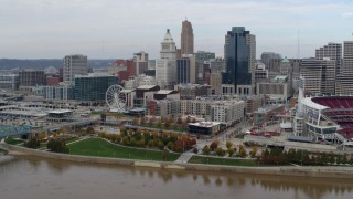 DX0001_002607 - 5.7K stock footage aerial video reverse view of the city's skyline seen from the river, Downtown Cincinnati, Ohio