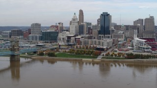 DX0001_002608 - 5.7K stock footage aerial video descend toward river with view of city's skyline, Downtown Cincinnati, Ohio