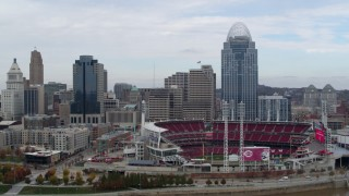 DX0001_002613 - 5.7K stock footage aerial video reverse view of skyscraper and baseball stadium from river, Downtown Cincinnati, Ohio