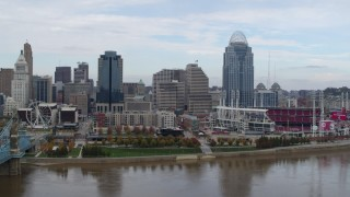 DX0001_002614 - 5.7K stock footage aerial video ascend and flyby riverfront baseball stadium and skyline, reveal bridge, Downtown Cincinnati, Ohio