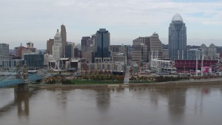 DX0001_002618 - 5.7K stock footage aerial video passing a riverfront baseball stadium and skyline, Downtown Cincinnati, Ohio