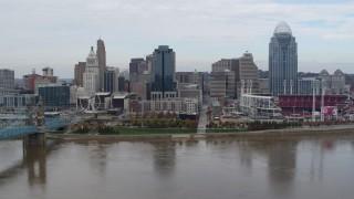 DX0001_002618 - 5.7K stock footage aerial video passing a riverfront baseball stadium and skyline, Downtown Cincinnati, Ohio