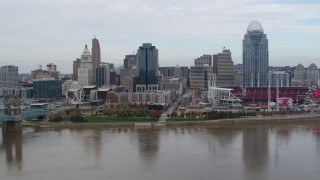 DX0001_002619 - 5.7K stock footage aerial video flyby a riverfront baseball stadium and skyline, Downtown Cincinnati, Ohio