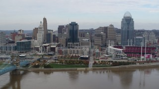 DX0001_002620 - 5.7K stock footage aerial video flyby a riverfront baseball stadium and skyline while ascending over river, Downtown Cincinnati, Ohio