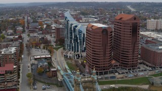 DX0001_002622 - 5.7K stock footage aerial video flying by modern condominium complex and two riverfront office buildings in Covington, Kentucky
