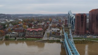 DX0001_002628 - 5.7K stock footage aerial video of flying by a bridge for view of two riverfront office buildings in Covington, Kentucky
