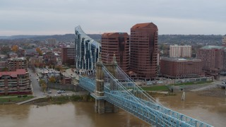 DX0001_002629 - 5.7K stock footage aerial video of flying by a bridge for view of condo complex and two riverfront office buildings in Covington, Kentucky