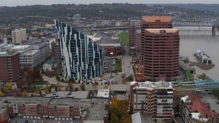 DX0001_002632 - 5.7K stock footage aerial video of passing by a condo complex and two riverfront office buildings in Covington, Kentucky