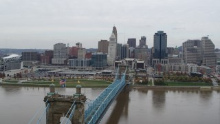 DX0001_002637 - 5.7K stock footage aerial video fly close to the Roebling Bridge and away from the city skyline, Downtown Cincinnati, Ohio
