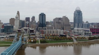 DX0001_002646 - 5.7K stock footage aerial video of flying toward the city's downtown skyline across the Ohio River, Downtown Cincinnati, Ohio
