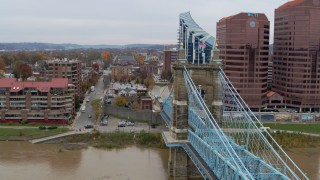 DX0001_002654 - 5.7K stock footage aerial video descend by Roebling Bridge toward the Ohio River in Covington, Kentucky
