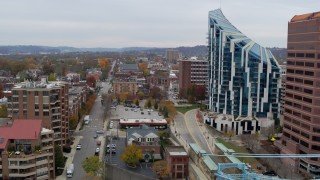 DX0001_002655 - 5.7K stock footage aerial video ascend by city street with view of condo complex in Covington, Kentucky