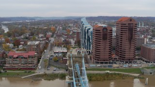 DX0001_002656 - 5.7K stock footage aerial video reverse view of city street and condo complex, reveal office buildings in Covington, Kentucky