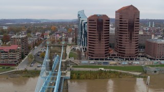 DX0001_002657 - 5.7K stock footage aerial video flyby bridge and office buildings, reveal riverfront condo complex in Covington, Kentucky