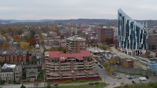 DX0001_002658 - 5.7K stock footage aerial video ascend by riverfront condo complex for view of brick buildings in Covington, Kentucky