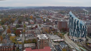 DX0001_002659 - 5.7K stock footage aerial video reverse view of brick buildings near condo complex in Covington, Kentucky