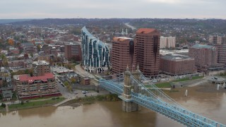 DX0001_002660 - 5.7K stock footage aerial video flyby and reverse view of condo complex, office buildings and Roebling Bridge in Covington, Kentucky