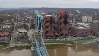 DX0001_002661 - 5.7K stock footage aerial video following Roebling Bridge past office buildings to approach condo complex in Covington, Kentucky