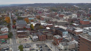 DX0001_002664 - 5.7K stock footage aerial video reverse view of brick buildings in downtown in Covington, Kentucky