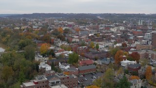DX0001_002666 - 5.7K stock footage aerial video of flying away from brick buildings in downtown, Covington, Kentucky