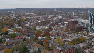 DX0001_002667 - 5.7K stock footage aerial video of flying by brick buildings in downtown to reveal modern condo complex, Covington, Kentucky