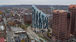 DX0001_002668 - 5.7K stock footage aerial video of flying by modern condo complex before descent, Covington, Kentucky