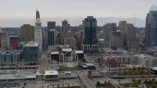 DX0001_002670 - 5.7K stock footage aerial video of flying by tall skyscrapers and skyline near Ferris wheel in Downtown Cincinnati, Ohio