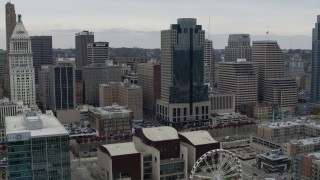DX0001_002677 - 5.7K stock footage aerial video of a reverse view the Scripps Center skyscraper, reveal Ferris wheel in Downtown Cincinnati, Ohio