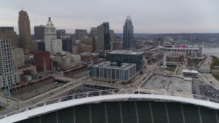DX0001_002680 - 5.7K stock footage aerial video of apartment and office buildings near skyscrapers seen from the football stadium in Downtown Cincinnati, Ohio