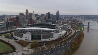 DX0001_002682 - 5.7K stock footage aerial video reverse view of football stadium and skyline, reveal Ohio River in Downtown Cincinnati, Ohio