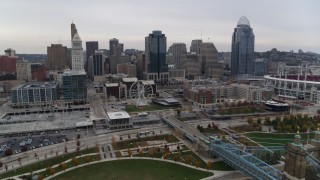 DX0001_002686 - 5.7K stock footage aerial video descend with view of city's skyline from the Ohio River in Downtown Cincinnati, Ohio