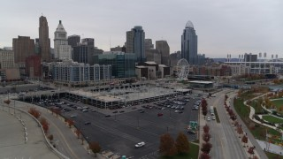 DX0001_002692 - 5.7K stock footage aerial video descent near parking lot with view of the city's skyline in Downtown Cincinnati, Ohio