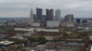DX0001_002696 - 5.7K stock footage aerial video ascend for view of skyscrapers in skyline in Downtown Columbus, Ohio