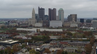 DX0001_002697 - 5.7K stock footage aerial video descend with view of skyscrapers in skyline in Downtown Columbus, Ohio