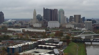 DX0001_002699 - 5.7K stock footage aerial video descend with view of the city's skyline and the Scioto River in Downtown Columbus, Ohio
