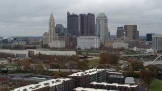 DX0001_002701 - 5.7K stock footage aerial video slowly fly away from the city's skyline and the Scioto River in Downtown Columbus, Ohio