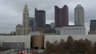 DX0001_002702 - 5.7K stock footage aerial video ascend from museum to view the city's skyline in Downtown Columbus, Ohio