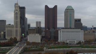 DX0001_002705 - 5.7K stock footage aerial video passing by four tall skyscrapers in the city's skyline in Downtown Columbus, Ohio