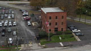 DX0001_002715 - 5.7K stock footage aerial video ascend while approaching a brick police station in Columbus, Ohio