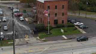 DX0001_002716 - 5.7K stock footage aerial video descend and fly away from a brick police station in Columbus, Ohio