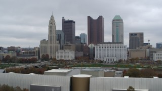 DX0001_002717 - 5.7K stock footage aerial video ascend near science museum for view of city's skyline, Downtown Columbus, Ohio