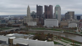 DX0001_002718 - 5.7K stock footage aerial video of flying by the city's skyline across the Scioto River, Downtown Columbus, Ohio